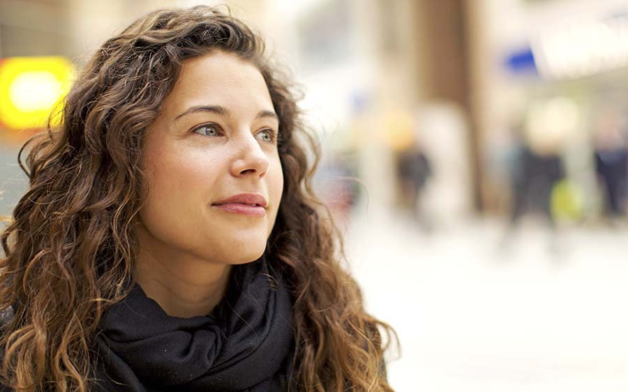 Portrait of attractive young woman gazing positively